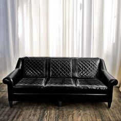 Sofa no. Two Twenty in quilted black distressed leather with contrasting grey stitch. library rolled arm sofa
