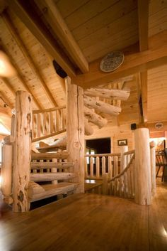 decoration brilliant log home spiral staircases using natural wood handrails under knotty pine ceiling planks and porcelain wall decor on laminate flooring near wrought iron stools