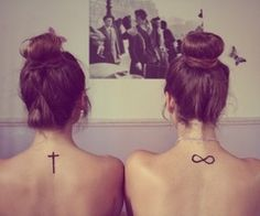 Infinity Tattoo and cross tatto im getting them both except on my finger