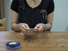 A student of Yoko Saito demonstrates her hand sewing technique...
