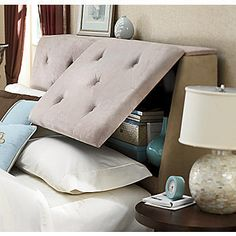 padded headboard with hidden storage. But I would want mine to slide up. That way you don't have to get out of the way to open it.