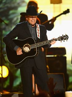 George Strait Photos - Musician George Strait performs onstage during the 48th Annual Academy of Country Music Awards at the MGM Grand Garden Arena on April 7, 2013 in Las Vegas, Nevada. - 48th Annual Academy Of Country Music Awards - Show