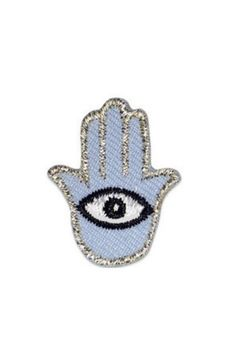 """Our good luck Hamsa Hand hipstapatch™ has an evil eye, to give its wearer even more good luck! This light blue embroidered fabric mini patch has a peel-and-stick adhesive backing. You can stick it on your shoes, cell phone case, backpack, pocketbook, skateboard, bike and more.    measures approximately 1"""" x 1""""   Hamsa Patch by Hipstapatch. Accessories - Other New York"""