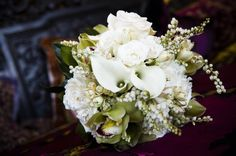 majolica and vendela roses, fragrant tuberose, calla lillies and touches of chartreuse cymbidium orchids