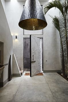 Handmade lampshade made out of copper design by osiris hertman, the inside of the frontdoor has a floral pattern cut out of wood by local craftsmen