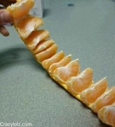 Leave it to Pinterest to make ya feel dumb.. Cut or pull the top and bottom circles from the orange/tangerine. Then slit between two sections and roll it out. MIND BLOWN.