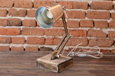 Office lamp Wooden Desk Lamp - Desk Lamps - Unique, accent wooden lamp made of solid lime wood and metal shade. Especially for you as an accent for your home, it will give new …    Read More »  #Concept #Desklamp #Handmadelighting #Industrial #Lamp #Lampshade #Lightfixture #Lighting #Lightingdesign #Metallic #Recycle #Steampunk #Steel #Woodlamp #Woodworking