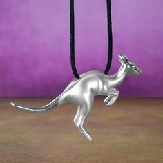 Unique Kangaroo Long Necklace Pendant - Solid Sterling Silver australian animal jewelry, in matte finishing with glossy details to highlight the design. A micro-sculpture in a jewel! This jewelry have a wonderful detailing and flawless 3D craftsmanship with my unique repousse technique. 3.6 cm (1.417 inch) X 2.4 cm (0.944 inch) on an adjustable 70 cm (27.559 inch) cord. #kangaroo #kangaroonecklace #kangaroopendant #kangaroojewelry #kangaroogift #silverkangaroo #kangaroojewellery