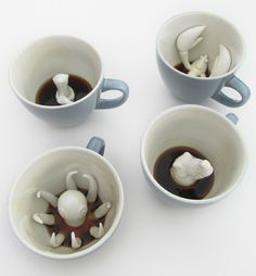 Unique coffee and tea cups feature hidden three-dimensional creatures that slowly emerge as you drink your favorite beverage. Designed by Yumi, handmade cups are dishwasher and microwave safe.