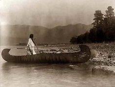 Here for your perusal is an original photograph of Country Kutenai Flathead Lake Montana. It was created in 1910 by Edward S. Curtis.    The photograph illustrates Kootenai Indian standing an elk hide canoe which is beached on the rocky shore of Flathead Lake, Montana.    We have compiled this collection of photographs mainly to serve as a valuable educational resource. Contact curator@old-picture.com.