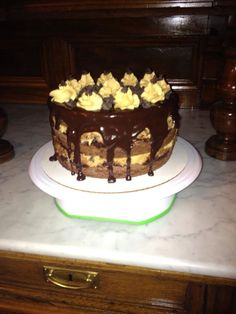 Brownie peanut butter chocolate chip cookie dough cake with chocolate ganache and peanut butter buttercream