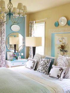To maintain a light and airy look, use blue as an accent in a space filled with neutral hues. In this white and sandy yellow bedroom, a country French blue infuses the space with subtle personality. While the combination could easily lean antique cottage, the color palette is kept up-to-date with contemporary florals and geometric motifs. Also, love the vanity