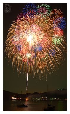 """""""Fireworks in Japan are better than that of any other country (except perhaps China). The shows last twice as long as they normally do, and usually involve larger fireworks as well. This photo was taken during the summer festival near Tokyo. For an entire hour, the sky was filled with magnificent fireworks ranging in colors.""""  Tokyo Lights - Hayama Harbor"""