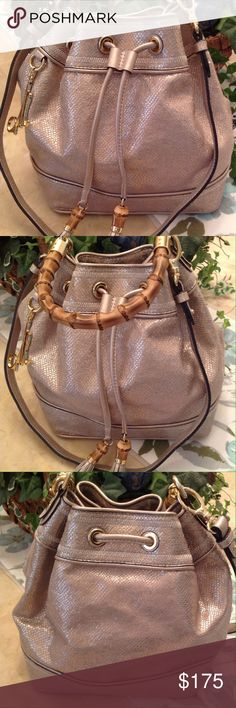 """💕 NWOT Gorgeous Sack Bag by Milly 12"""" (L) x 12"""" (H) x 7 1/2"""" (W), gold metallic glitter with wood accented drawstring closure, wooden handle with 6 1/2"""" drop, 20"""" drop shoulder strap, cell phone and multi-function pockets, fabric lining. Milly Bags"""