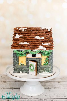 Gingerbread season has officially started in our house! Our first gingerbread decorating party of the year is this Friday (the second is Saturday!), and I've completed my first decorated gingerbread house: a very special gingerbread cottage for the PANDA Christmas party.