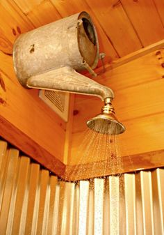 "Would be super cute for an outdoor shower, especially around a pool. A creative shower head using a watering can! Many other repurposed cabin decorating takes in this post too. -- Cozy Old ""Farmhouse"": Cutest {Junkiest} Vintage Cabin."