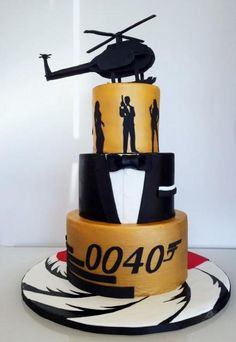 James Bond 3 tier Cake with Tuxedo Middle Layer, Silouettes and Helicopter on top.JPG Hi-Res HD Thème James Bond, James Bond Cake, James Bond Party, Marvel Birthday Cake, 60th Birthday Cake For Men, Marvel Cake, Call Of Duty Cakes, Brithday Cake, Beautiful Birthday Cakes