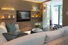 Recessed tv, floating shelves and built-in's matching the wall treatment...comfortable yet sleek. Taylor Howes