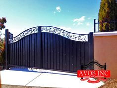 Avos inc privacy Gate with sheet metal and scroll work at top