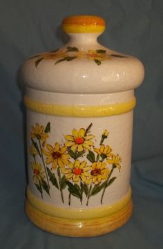 Vintage Cookie Jar made in Japan for Sears & Roebuck What a pretty sunny looking cookie jar. This wouldn't look out of place in our kitchens today
