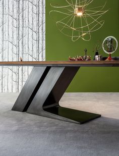 The TL table designed for Bonaldo by Giuseppe Viganò gets its name from the singular shape of the central leg, comprising two inclined elements which with the Industrial Design Furniture, Office Furniture Design, Wood Table Design, Dining Table Design, Steel Furniture, Cool Furniture, Esstisch Design, Dinning Room Tables, Steel Table