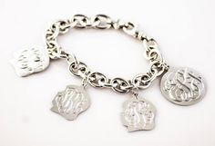 Hand engraved monograms make up this fabulous Family Heritage Bracelet! Totally customized with your family's information, this bracelet is available in sterling silver and 14k white or yellow gold. You can build it all at once or add to it over the years. Truly a unique way to share your story with the world.