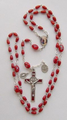 All sizes | I finally finished the Mary Magdalene rosary! Red, egg-shaped coral (not endangered species) beads, with lampwork oval Our Fathers., via Flickr.