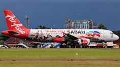 AirAsia (MY) Airbus A320-214 9M-AHT aircraft,  painted in ''Thank you Sabah'' special colours Nov. 2014, (2nd version), skating at Indonesia Adisucipto (or Adisutjipto) International Airport. 14/02/2017.