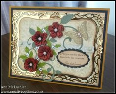Spellbinders dies, gold mirror card, glitter brads, pearls on the butterfly and silver rhinestone flowers. The Cheery Lynn dies used are Exotic Butterfly, Fanciful Flourish, Leaf Flourish Strip, Build A Flower # 1 & 3 Embellishments.  creativeoptions.co.nz