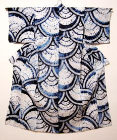 Cotton Yukata (informal summer kimono) Shibori: The seigaiha (literally blue ocean waves) pattern is very popular in Japanese design. Note the two shades of blue – from greater and lesser saturation of the dye – which provide great contrast with the white ground.
