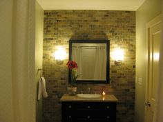 Like the square in scale mirror balanced by sconce type lights