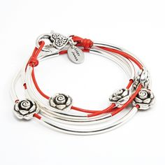 "Mini Rosie Medium Bracelet With Gloss Red Leather by Lizzy James. Handcrafted Two Leather Strand Wrap Bracelet. FOR SIZING YOUR WRIST: If the string measures 6 1/4"" - 6 1/2"" without slack - your size is Medium. Great Gift For Mother's Day, Graduations, Anniversaries, Birthdays, Christmas, Valentine's Day, Girlfriends, Moms, Grandmothers, Significant others, and more. Please Allow For Slight Leather Color Variation Due To Its Organic Nature. Handmade In The USA."