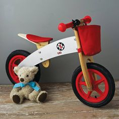 A fabulous wooden balance bike that can be personalised to make it extra special.  We love this wooden bike with pneumatic tyres and height adjustable seat. Nice good quality solid construction, chunky tyres, bell and great wheels. You can attach or detach a useful bottle holder at the front. It comes in a racing red or girlie pink colour. This bike will guarantee hours of fun zooming around and prepare for the real thing.  Recommended age 3 to 6  Please allow extra 2 - 3 days for delivery…