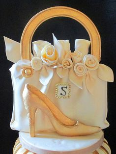 Edible Purse Is Fondant Covered Rice Krispy Treats And Two Dimensional Gumpaste Shoe by tanyacakes, via Flickr
