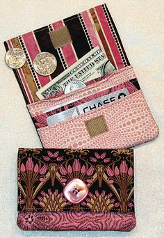 wonder_wallet_cover.jpg by Lazy Girl Designa.  I use this for little used store membership cards and my MAD MONEY!