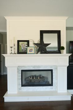 Camille Roskelly's Remodeled Family Room info: Paint: Rainwashed by Sherwin Williams Trim/fireplace: Swiss Coffee Couch: RC Willey outlet Chair: West Elm a few years ago Tile around fireplace: Lowes *Camille Roskelley's blog of before / after's of this fireplace redo is quite fab - it's even better close-up!