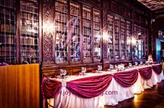 #Burgundy #head #table #décor with #rhinestone #buckles looks #perfect with the #fine #wood #bookcase as #background. (Venue: #Library, #Casa_Loma)