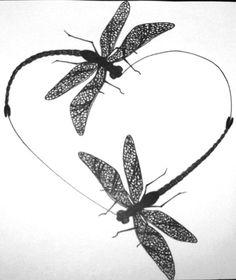 Dragonflies in a heart tattoo