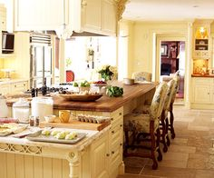 Putting a designated baking center at the end of an island makes plenty of room for helpers to gather around.  This baking center oozes character with its turned legs and detailed design. The marble top keeps dough cool while it is rolled out.