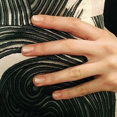 Fall Beauty Trends You Should Know About | Go bare like at Lela Rose (pictured), where nails were painted diagonally with a glowy gray. At Zimmerman, triangles at the base of the nail were left exposed, and at Emerson, sweeps of opposing color lined the vertical edges, while the center stayed free and clear.
