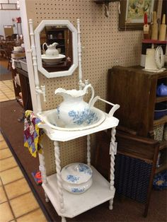 Great antique white painted wash stand with Pitcher and bowl set and matching chamber pot.  $165.00
