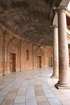 Granada, Spain - The Christian Palace of Ferdinand and Isabel on the Alhambra site. Took us by surprise. Square on the outside and built around an open circular courtyard on the inside.