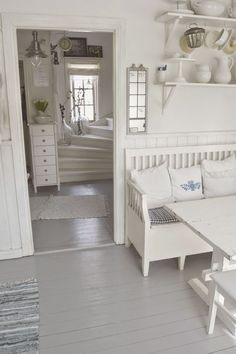 Do something like those back stairs for the stairs up to the attic in the farm house (window, light and bright)