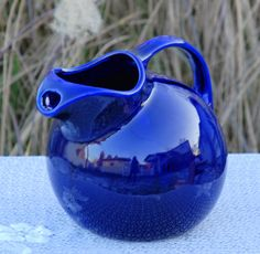 Incredible cobalt blue color! So vivid!  Vintage Cobalt Blue Tilted Ball Hall Pottery Pitcher With Ice Lip. $40.00, via Etsy. This color is stunning!