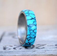 This ring is TruStone Turquoise Inlay over metal band. Additional wood and inlay…