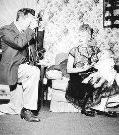 Desi Arnaz snaps a photo of the comedienne Lucille Ball and their infant son, Desi Jr., in their California home in January, 1953.