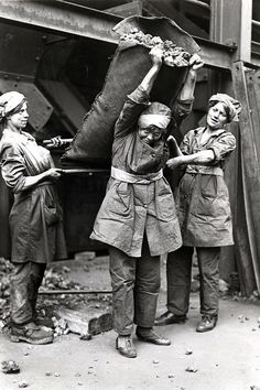 The Most Powerful Images Of World War I. Women hauling coal, possibly for a gas company.