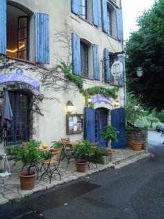 love the blue window shutters