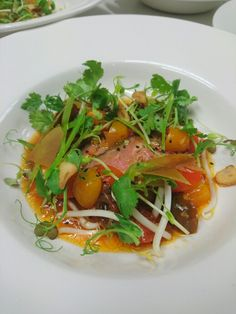 steak , ceviche tomatoes , mung bean sprouts , sugar snap peas , chips with miso