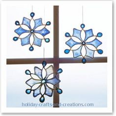 Stained Glue Snowflake Tutorial on this site: This is all you need to do this project:  White string  Thread (gold)  Wax paper  Tape  Elmer's glue  Paper cup  Watercolors (blue)  Paintbrush  Scissors  Glitter.  Easy to make & very pretty!